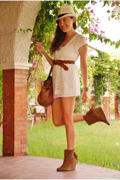 Girl with white dress and brown ankle boots